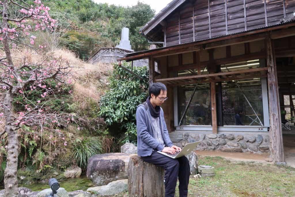 Yoichi Dan, 34, a software engineer at Sansan Inc., is working at an office in the mountain town of Kamiyama in Tokushima, southwestern Japan. Photographer: Keiko Ujikane/Bloomberg